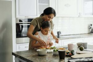 Woman and child in kitchen.