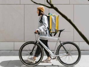 A delivery woman with her bike