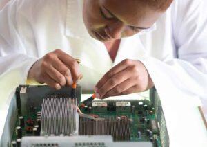 A woman repairing a computer