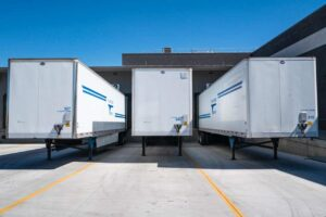 Truck trailers parked outside a warehouse