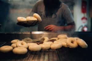 A person making bagels