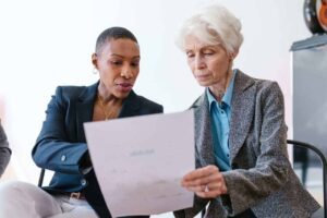 Two women examine data on a piece of paper